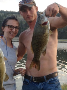 Smallmouth bass and rainbow trout caught by Dustin Schmit